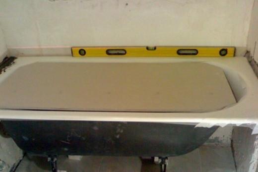 Выравнивание стальной ванны, фото