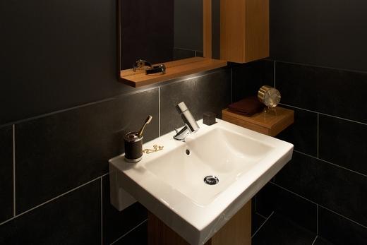 Смеситель бренда Орас в ванной комнате с оригинальным дизайном