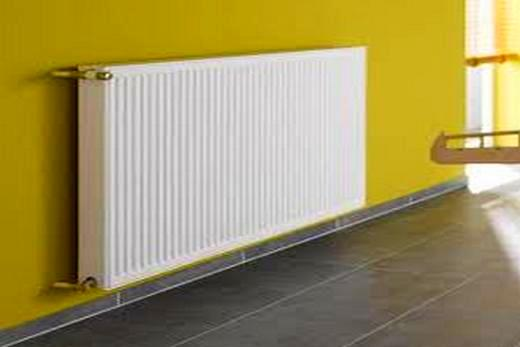 Интерьер комнаты с радиатором из стали марки Purmo