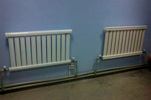 В интерьере помещения вакуумный радиатор