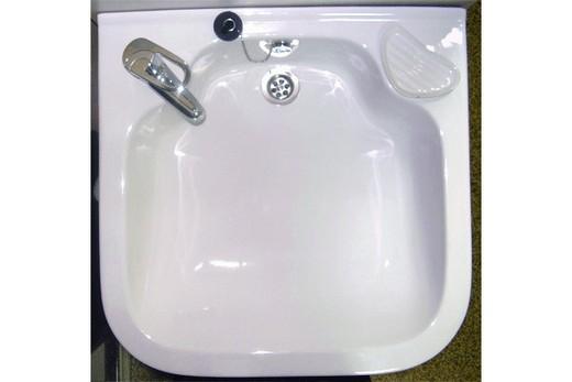 Расположение крана и слива на типичной раковине-ракушке, фото