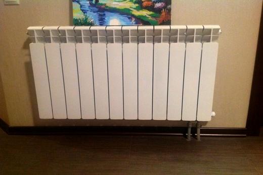 Интерьер гостиной с радиаторами марки Rifar Monolit