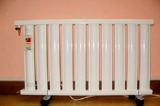 Интерьер помещения с электрическим вакуумным радиатором