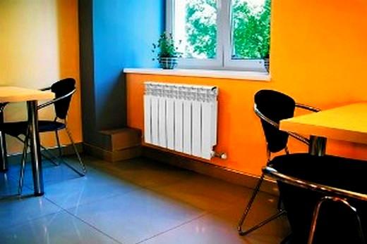 Интерьер столовой с радиаторами марки Rifar Monolit