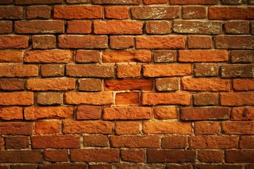 Если в кирпичной стене есть полости, то ее можно сразу штукатурить